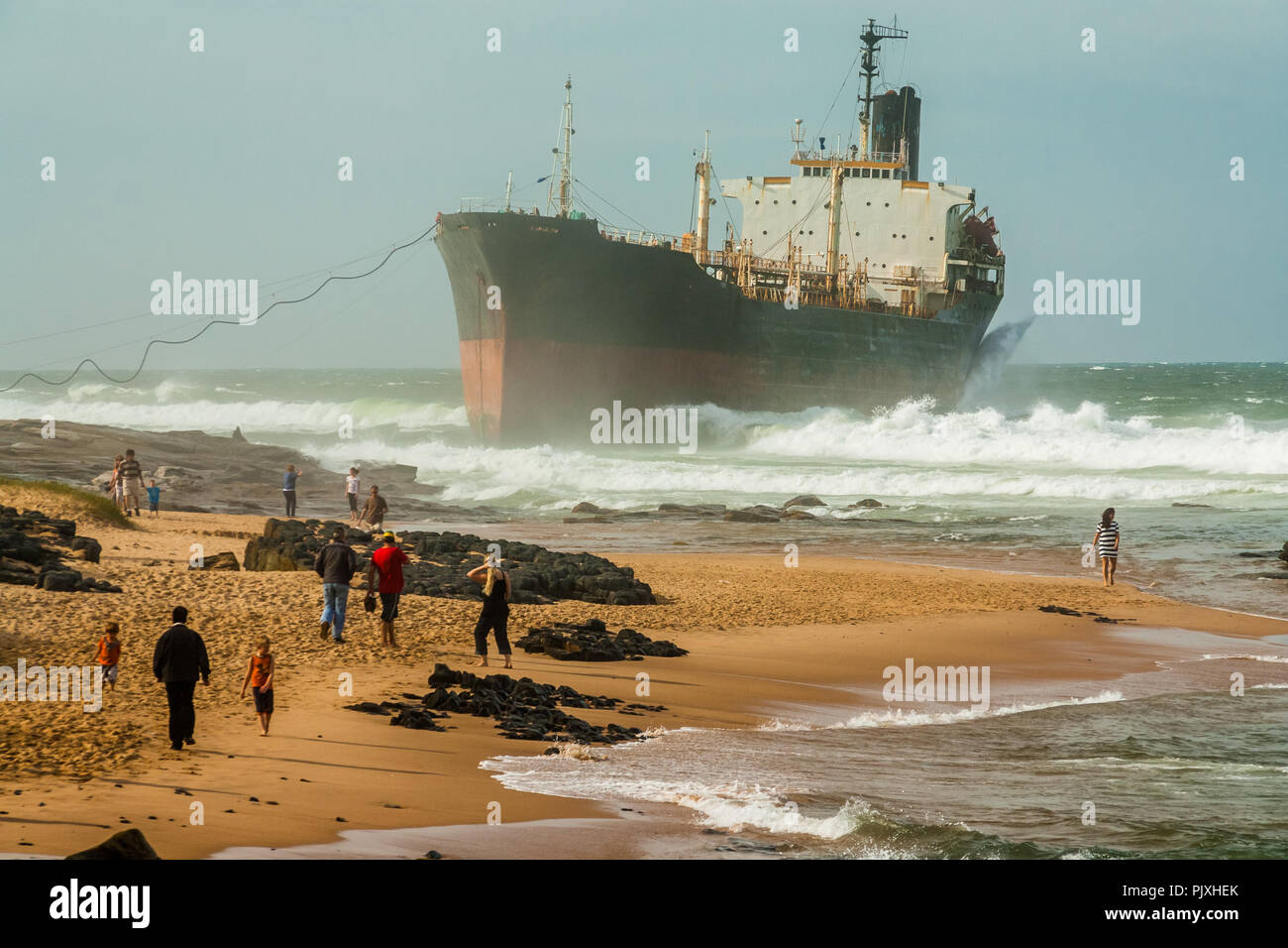 People flocking to see The Phoenix, a derelict bulk tanker, ran aground at Sheffield Beach on Durban's North Coast - Stock Image