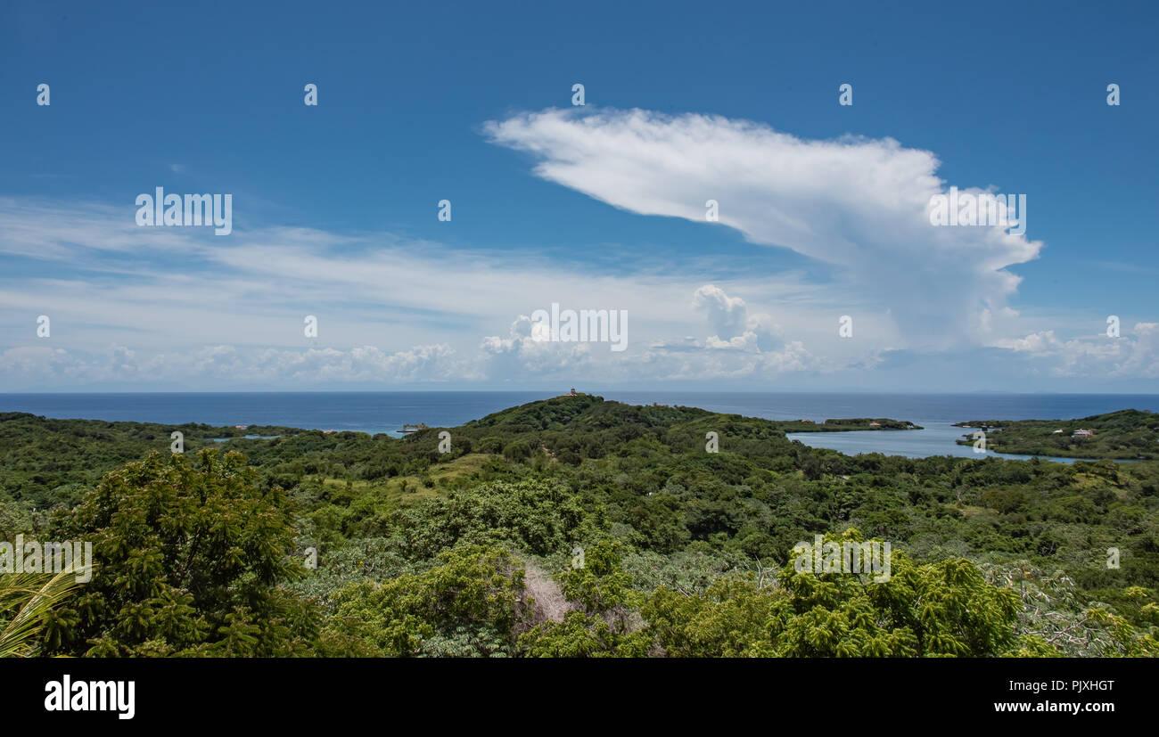 Cumulonimbus Anvil Cloud Off Caribbean Island - Stock Image