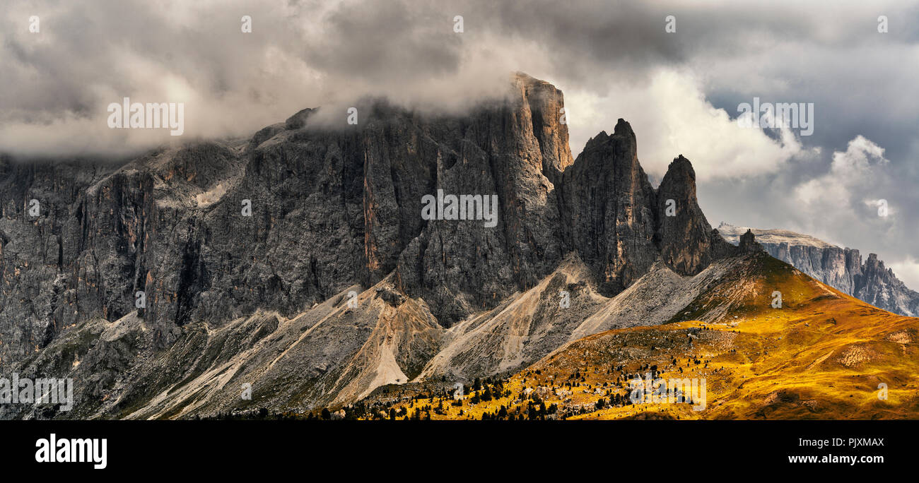 Storm clouds over the summit of Sella Group in a autumn afternoon, rainy season - Trentino-Alto Adige, Italy - Stock Image