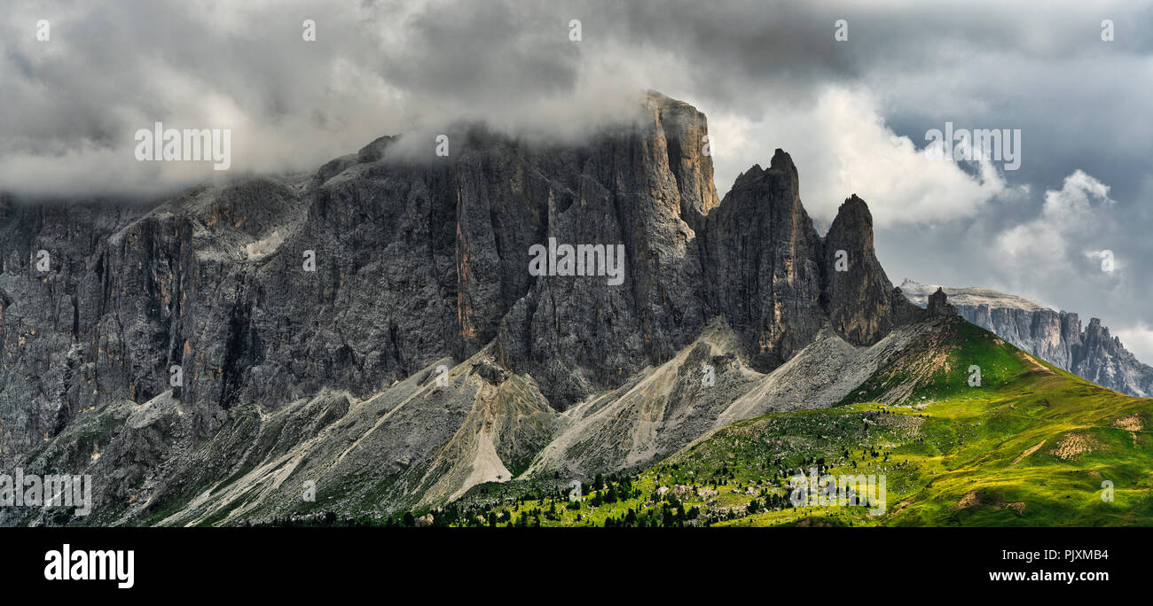 Storm clouds over the summit of Sella Group in a summer afternoon danger for mountain climbing - Trentino-Alto Adige, Italy - Stock Image