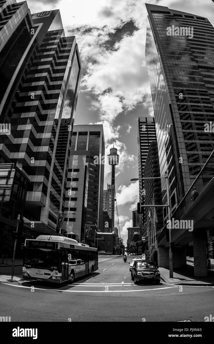 Sydney, Australia - January 12, 2009: Famous Sydney Tower Eye, known as Westfield Tower, between skyscrapers at Sydney street. - Stock Image
