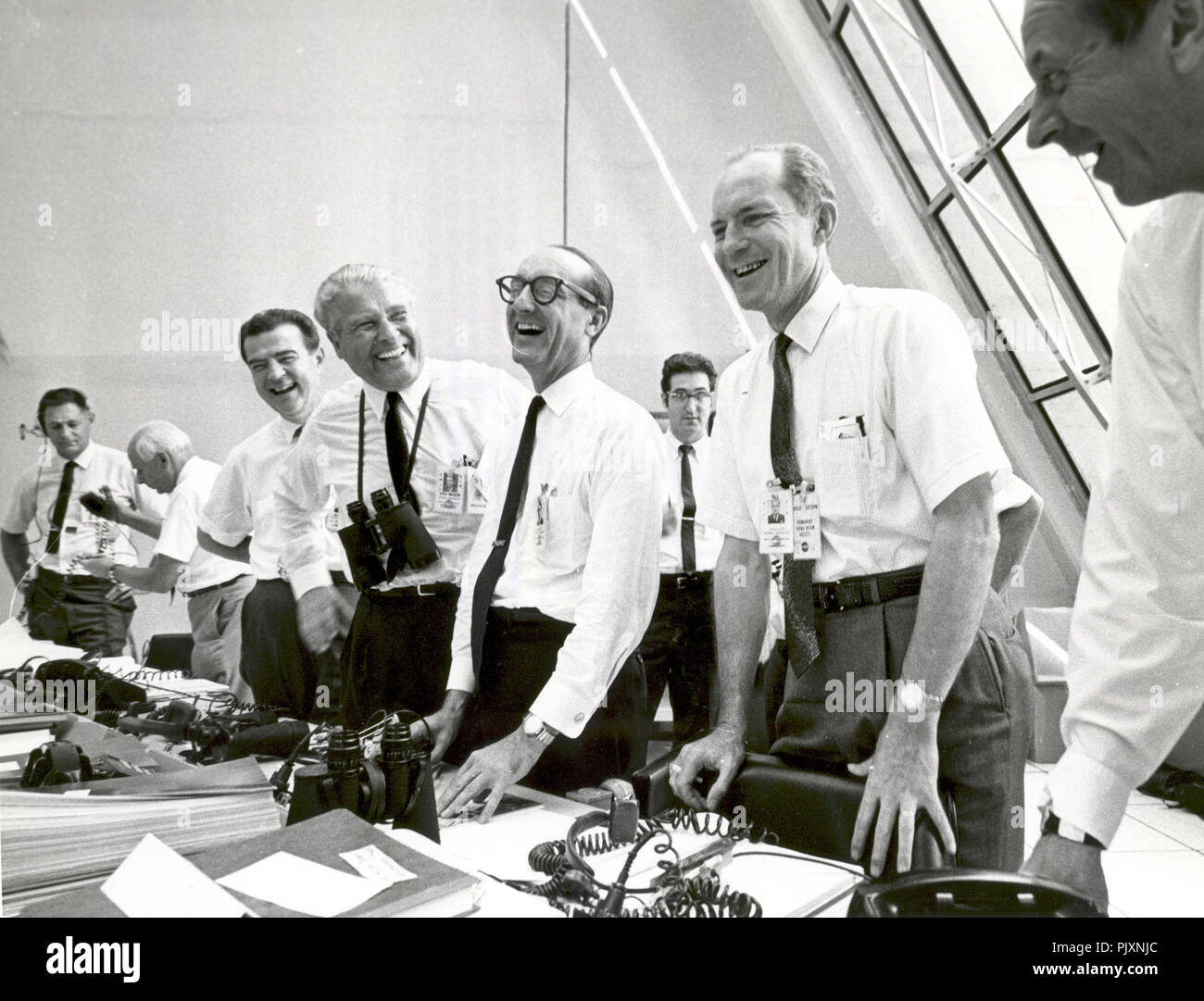 Cape Canaveral, FL - (FILE) -- Apollo 11 mission officials relax in the Launch Control Center following the successful Apollo 11 liftoff on Wednesday, July 16, 1969. From left to right are: Charles W. Mathews, Deputy Associate Administrator for Manned Space Flight; Dr. Wernher von Braun, Director of the Marshall Space Flight Center; George Mueller, Associate Administrator for the Office of Manned Space Flight; Lt. Gen. Samuel C. Phillips, Director of the Apollo Program Credit: NASA via CNP /MediaPunch - Stock Image