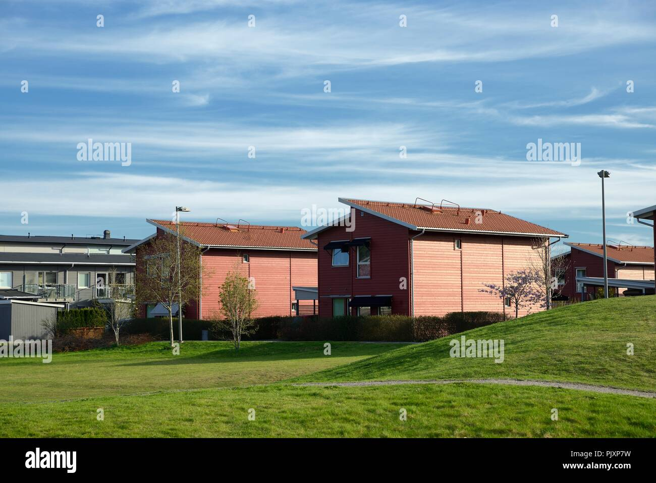 Environmental documentary of coastal lifestyle. Here a Swedish home in summer with blue sky. - Stock Image