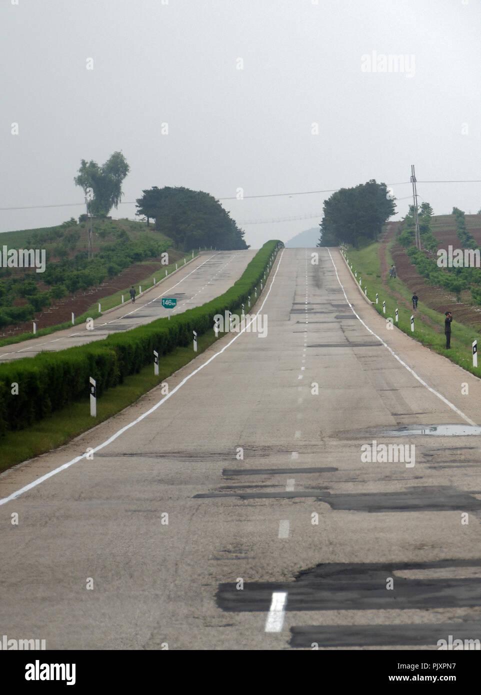 The empty Reunification highway outside Pyongyang, North Korea - Stock Image