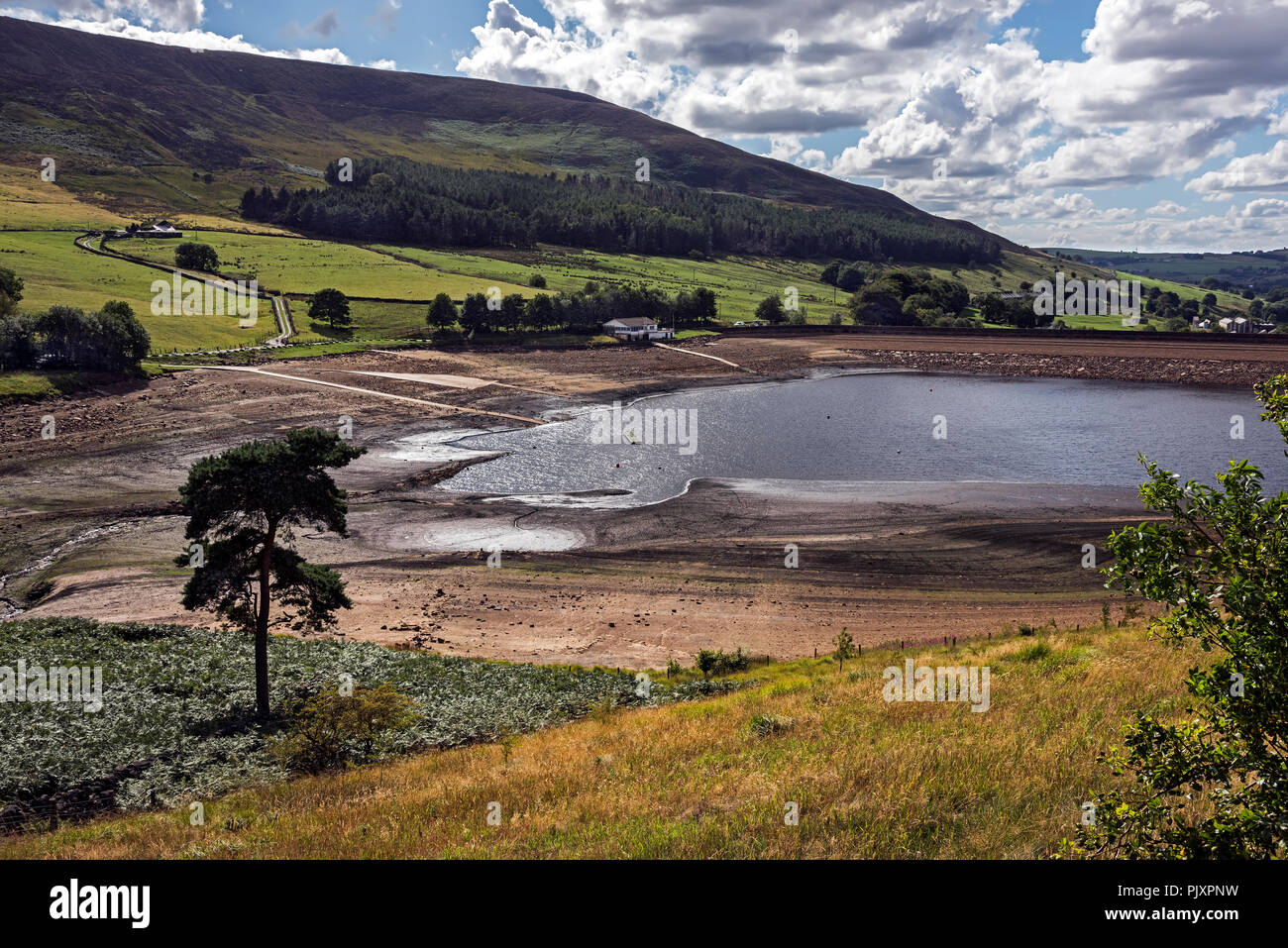 Low Water at Dovestone Reservoir, Greenfield, Oldham, Greater Manchester UK. - Stock Image