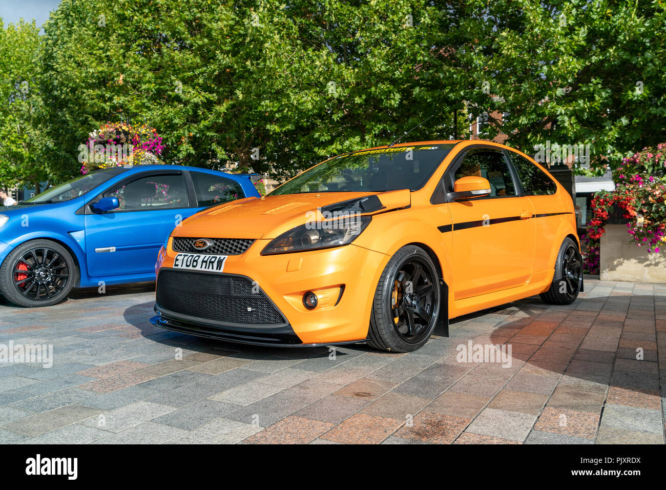 Orange modified Ford Focus ST hatch back car Stock Photo