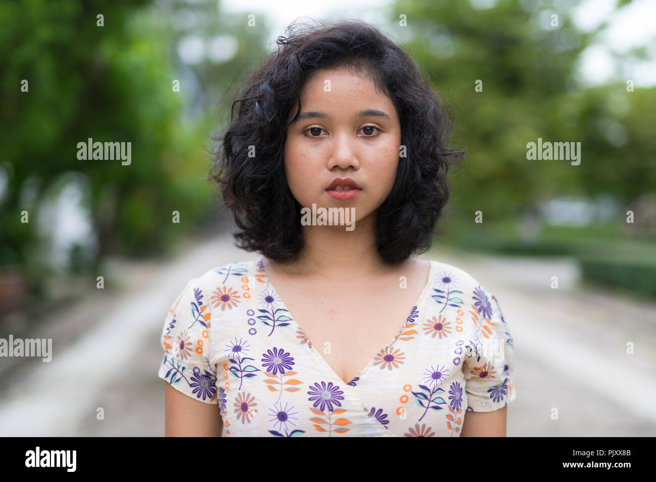 Beautiful Asian Woman With Short Curly Hair Outdoors Stock Photo Alamy