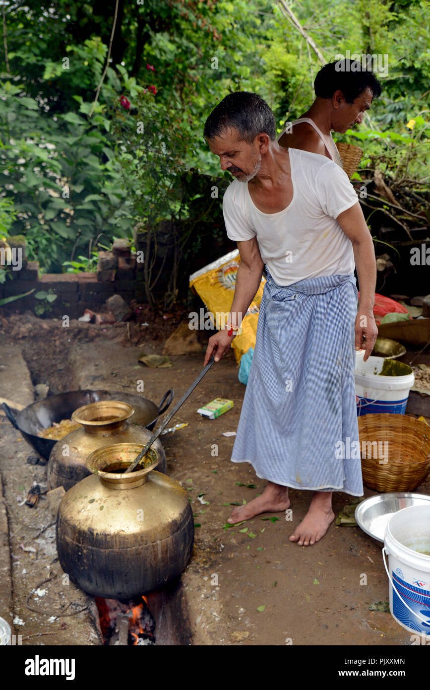 Cooking Food  Outdoors Using Fire Woods in Village - Stock Image