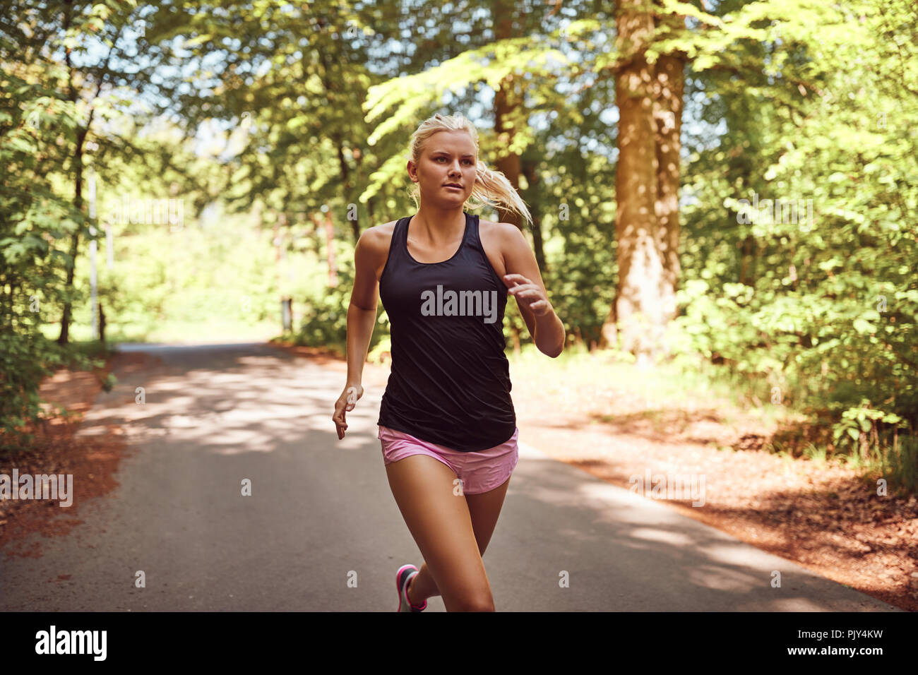 Fit Young Blonde Woman In Shorts And A Tanktop Jogging Alone On A Path Through A Forest On A Sunny Day Stock Photo Alamy One of many great free stock photos from pexels. https www alamy com fit young blonde woman in shorts and a tanktop jogging alone on a path through a forest on a sunny day image218184621 html