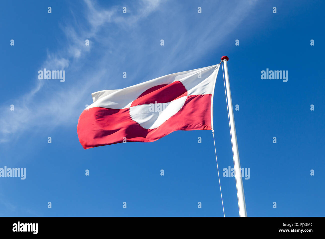 Greenlandic Flag on flagpole - Stock Image
