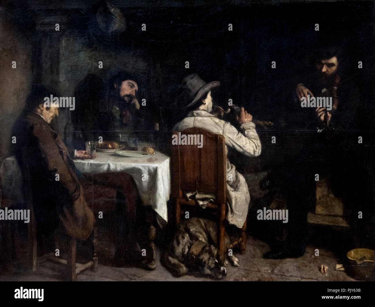 Gustave Courbet (1819-1877) 'After Dinner in Ornans' (L'Apres dInee a  Ornans), oil on canvas, 1849 - Stock Image