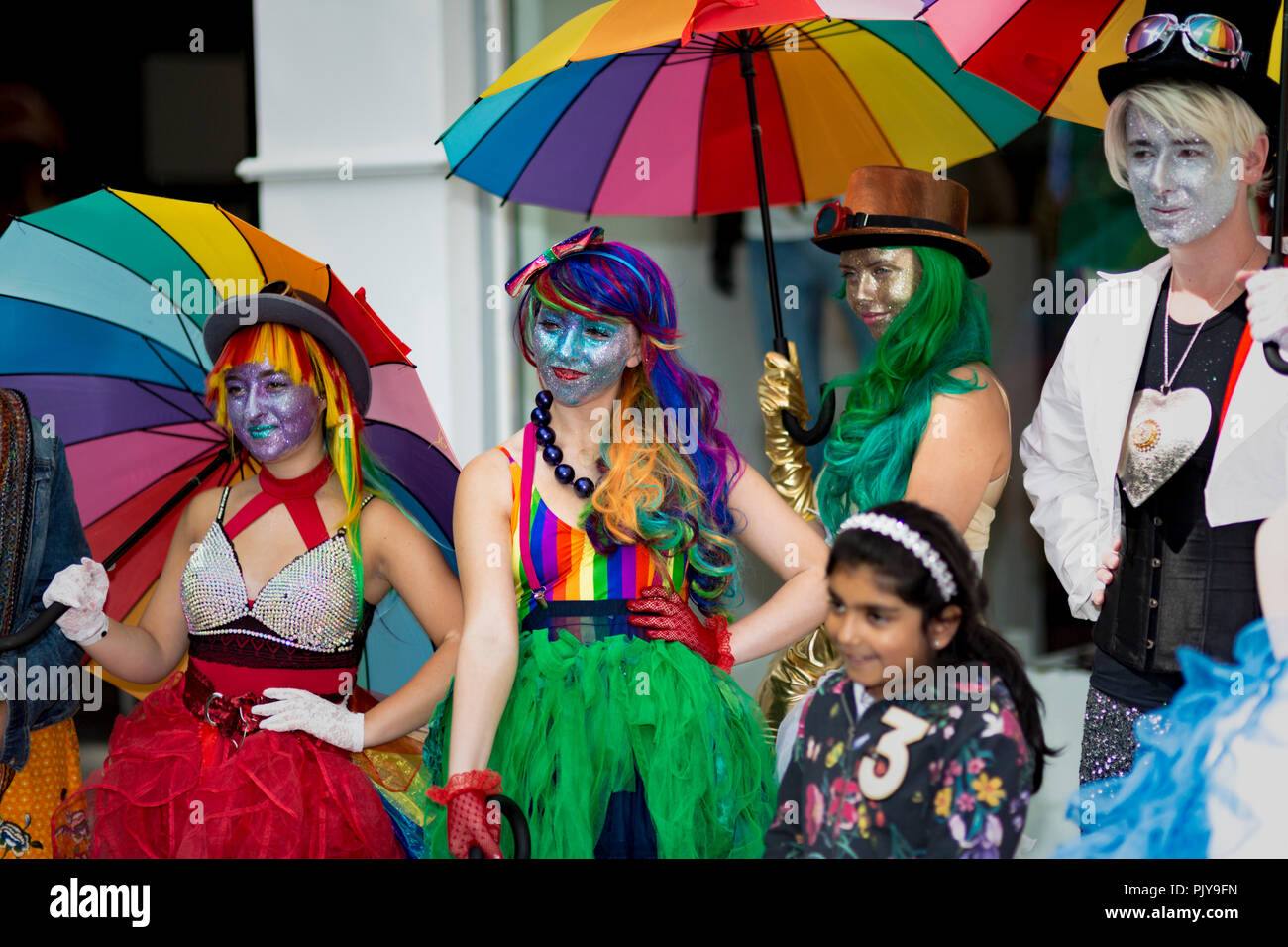 Cardiff, UK. August 2018. A display of brightly dressed and colourful street performers during this years Pride Cymru event. - Stock Image