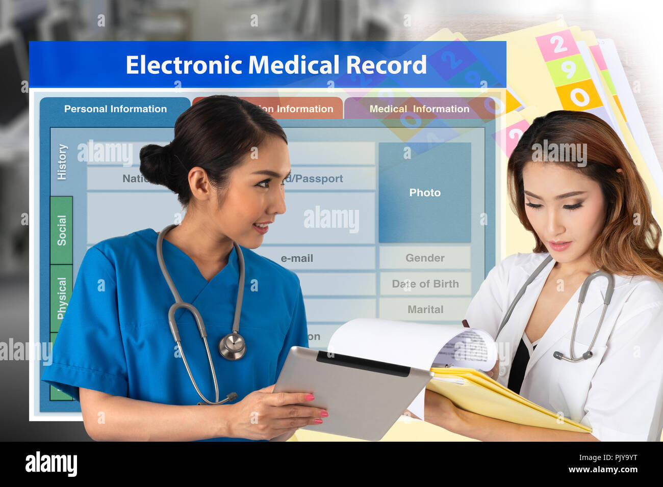 Two female doctors showing change of medical record technology from paper work to electronic medical record. - Stock Image