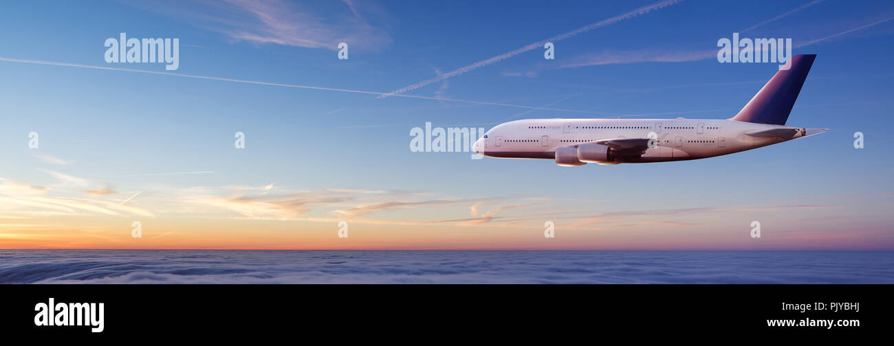Huge two-storey passengers commercial airplane flying above clouds in sunset light. Concept of fast travel, holidays and business. - Stock Image