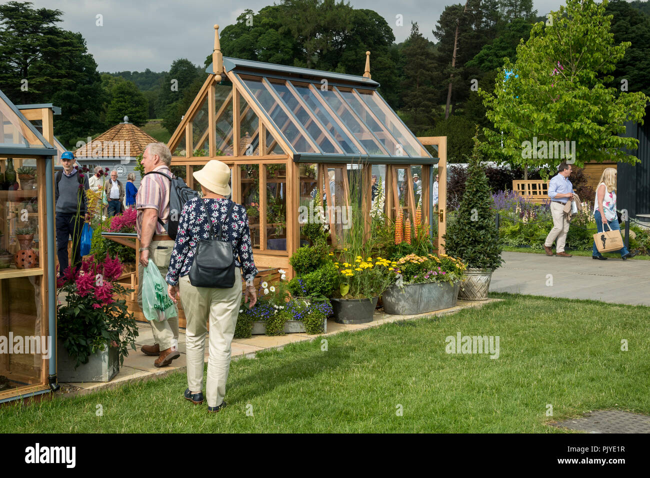 0ff8cee109ea7 People walking   having a look at greenhouses displayed   for sale on  attractive trade stand