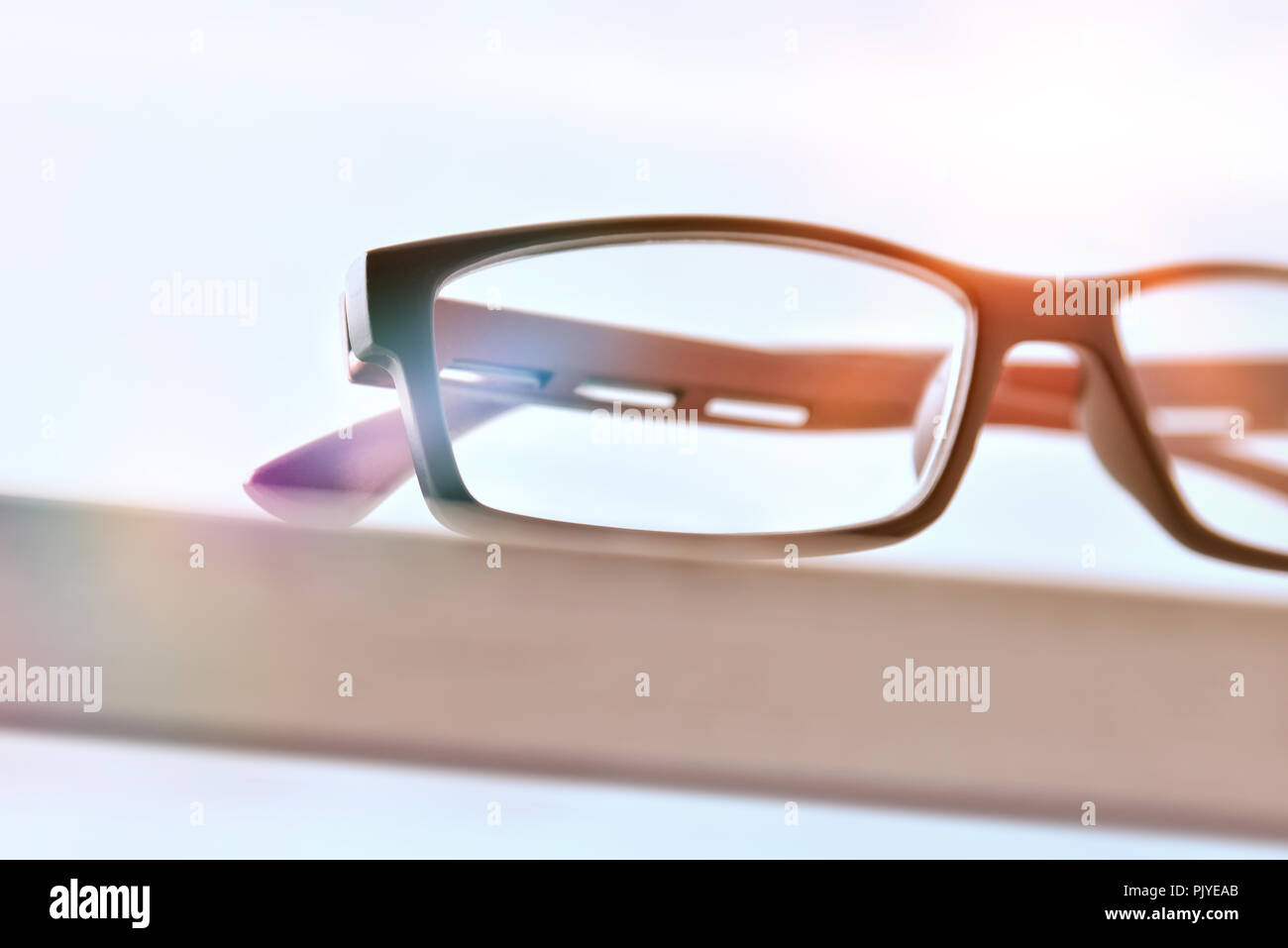 Eyewear on wood table and white background front view detail. Front view. Horizontal composition - Stock Image