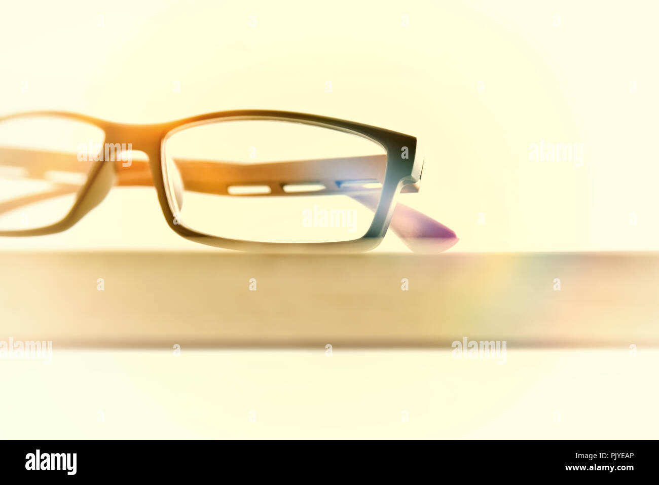 Eyewear on wood table front view detail vintage. Front view. Horizontal composition - Stock Image