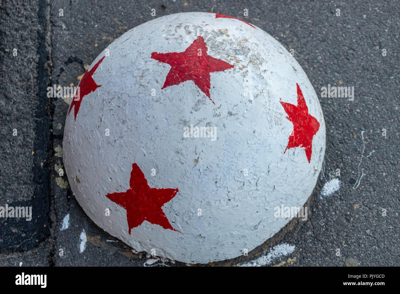Fencing on asphalt with asterisks - Stock Image