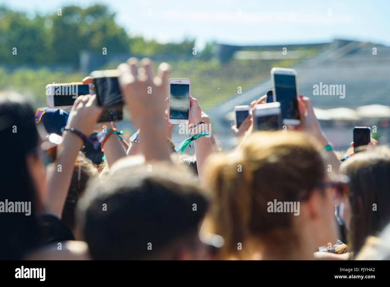 Berlin, Germany. 09th Sep, 2018. Visitors film a concert with their smartphones at the two-day music festival Lollapalooza on the grounds of the Olympic Park. Credit: Gregor Fischer/dpa/Alamy Live News - Stock Image
