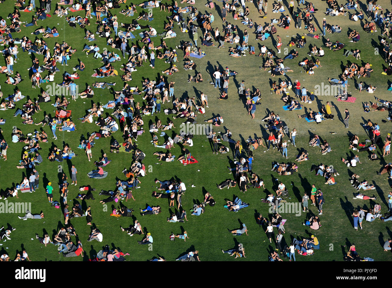 Berlin, Germany. 09th Sep, 2018. The music festival Lollapalooza takes place on the grounds of the Olympic Park. Numerous visitors lie on the meadow. Credit: Britta Pedersen/dpa/Alamy Live News - Stock Image