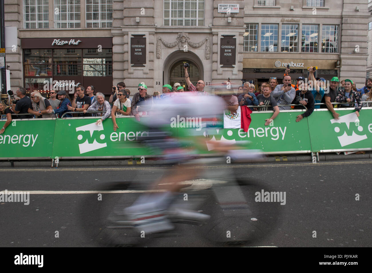 London, UK. 9 September, 2018. The OVO Energy Tour of Britain London Stage 8 concludes with a 14 lap circuit in central London on closed roads in front of large crowds and covering 77km at speeds of up to 80kph, starting and finishing on Regent Street St James's close to Piccadilly Circus. Connor Swift, British Road Race Champion, passes in a speed blur. Credit: Malcolm Park/Alamy Live News. - Stock Image