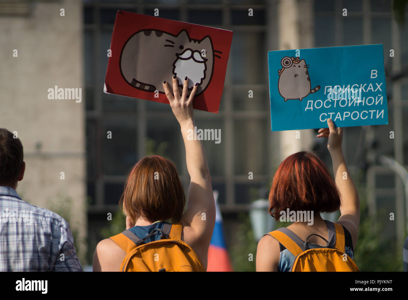 Moscow, Russia. 9th Sept 2018. Young women are holding a series of signs saying 'In Search of Dignified Retirement' during an anti-government rally in Moscow where Russian opposition activists gathered to express resentment about the upcoming pension refrom. Credit: Roman Chukanov/Alamy Live News - Stock Image