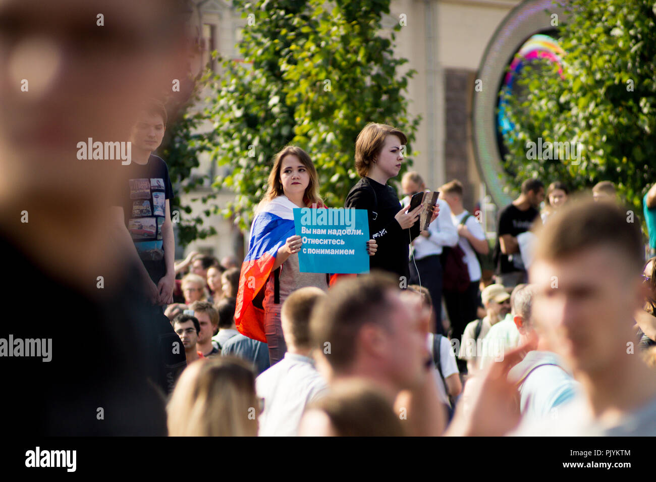 Moscow, Russia. 9th Sept 2018. A young woman is holding a sign saying 'We Are Tired of You. Show Some Understanding.' during an anti-government rally in Moscow where Russian opposition activists gathered to express resentment about the upcoming pension refrom. Credit: Roman Chukanov/Alamy Live News - Stock Image