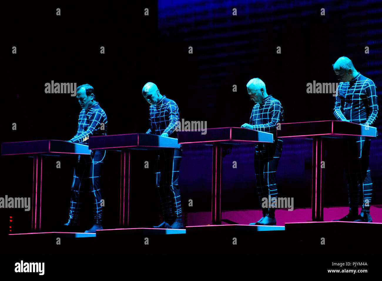 Berlin, Germany. 09th Sep, 2018. The members of the band Kraftwerk are on stage at the two-day music festival Lollapalooza on the grounds of the Olympic Park. Credit: Gregor Fischer/dpa/Alamy Live News Stock Photo