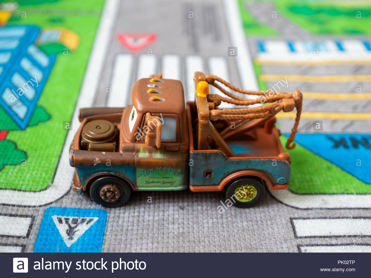 4bbe582b14 Mattel Disney Pixar toy Tow Mater on a play mat. Staged simulation of a Cars