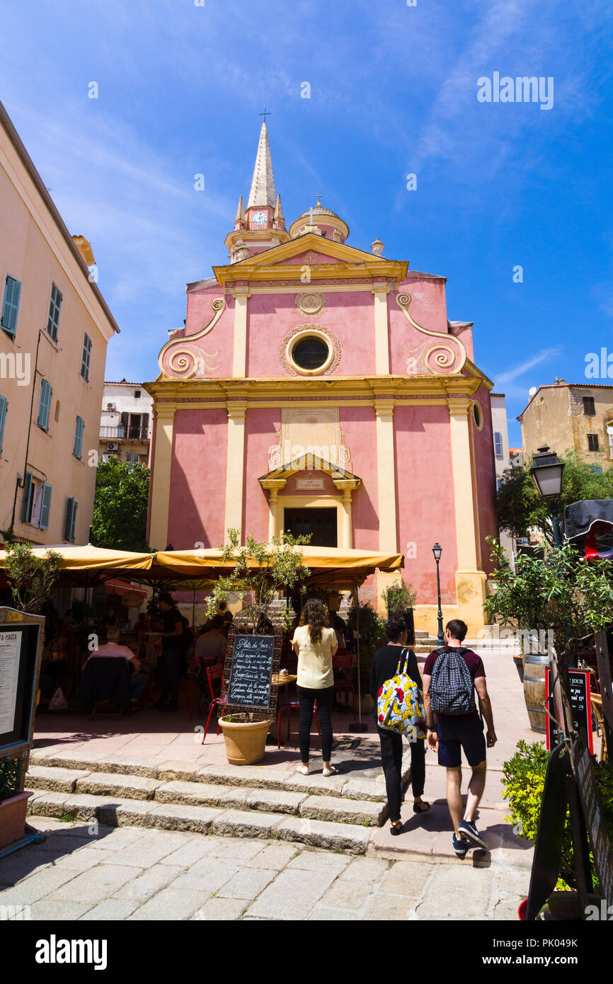 Outdoor restaurant patio in front of Saint-Marie Church, Calvi, Corsica, France Stock Photo