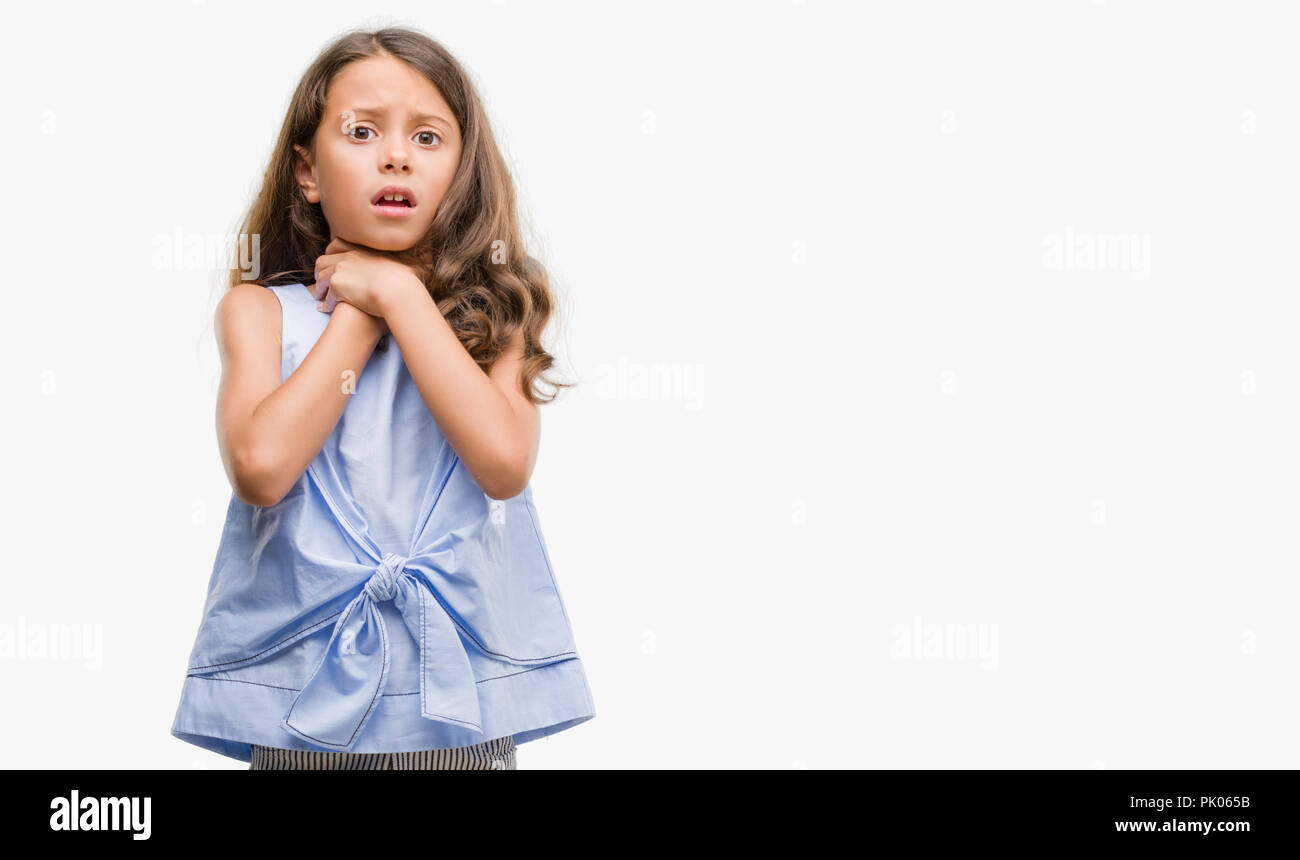 Brunette hispanic girl shouting and suffocate because painful strangle. Health problem. Asphyxiate and suicide concept. - Stock Image