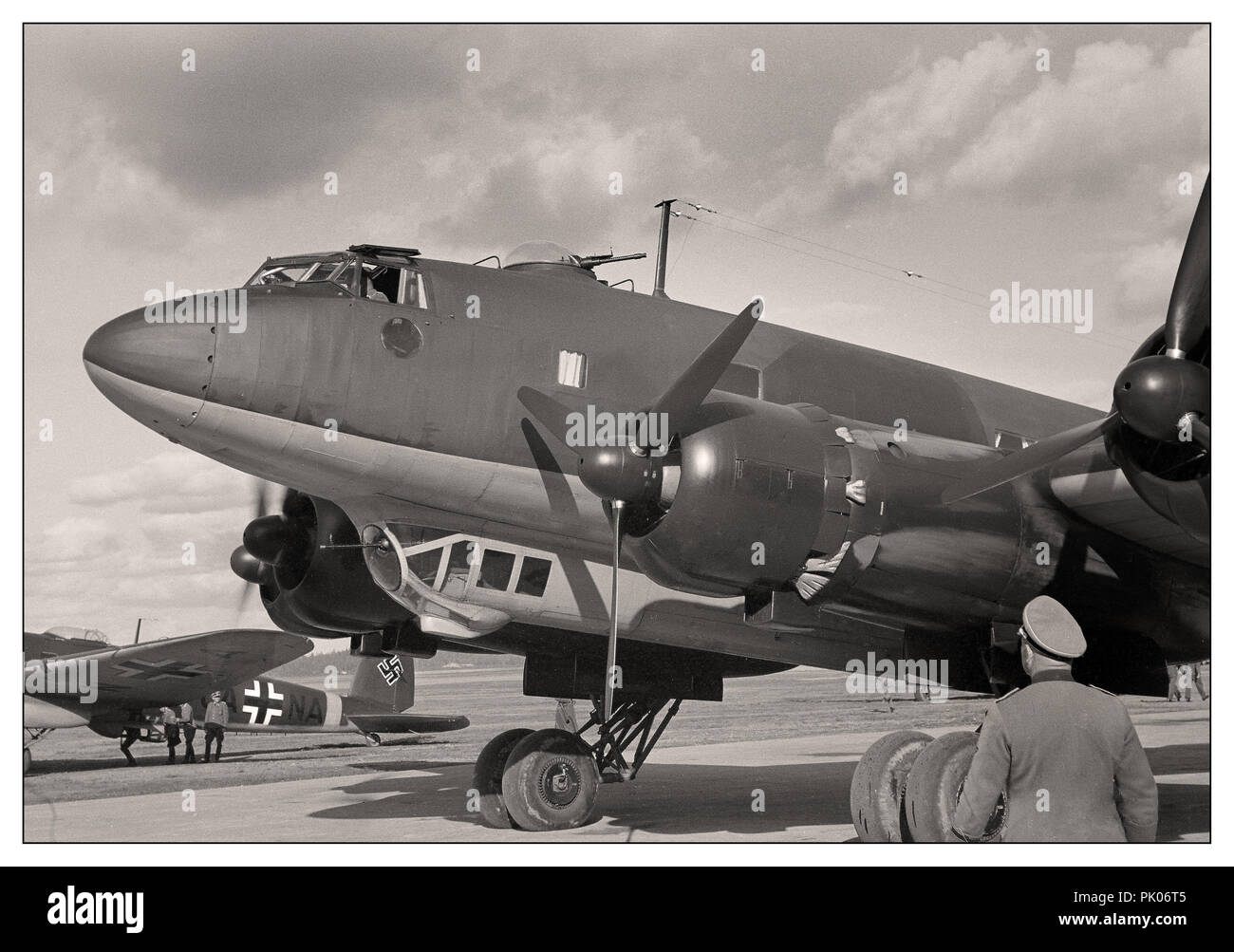 Adolf Hitler's personal Luftwaffe Focke-Wulf Fw 200 Condor with Nazi Swastika insignia fighter escort at Immola Airport during his visit to see Field Marshal Mannerheim 4 June 1942 in Finland - Stock Image