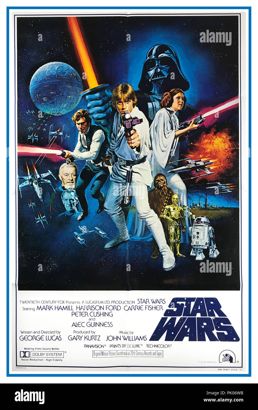 "STAR WARS, 1977. Original international style movie film poster starring Mark Hamill, Harrison Ford, Carrie Fisher, Alec Guinness, Peter Cushing and directed by George Lucas. ""A long time ago in a galaxy far, far away…"" - Stock Image"