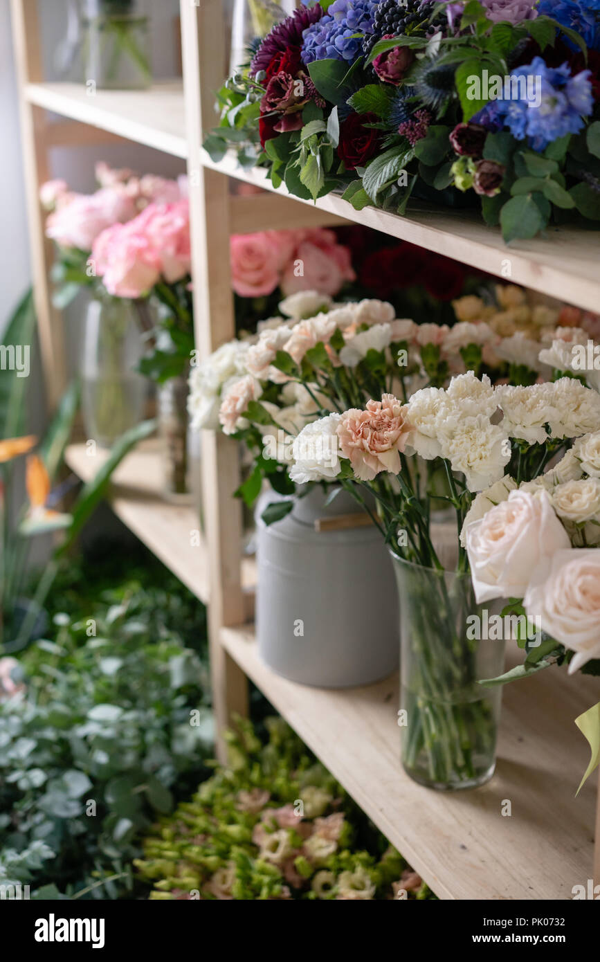 Flower shop concept different varieties fresh spring flowers in flower shop concept different varieties fresh spring flowers in refrigerator room for flowers bouquets on shelf florist business mightylinksfo