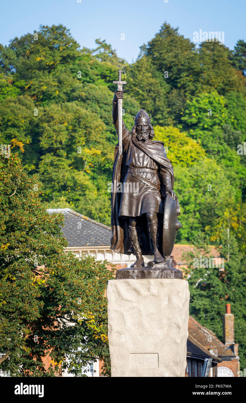 Iconic statue of King Alfred the Great in The Broadway, Winchester, Hampshire, southern England, UK, St Giles Hill behind - Stock Image