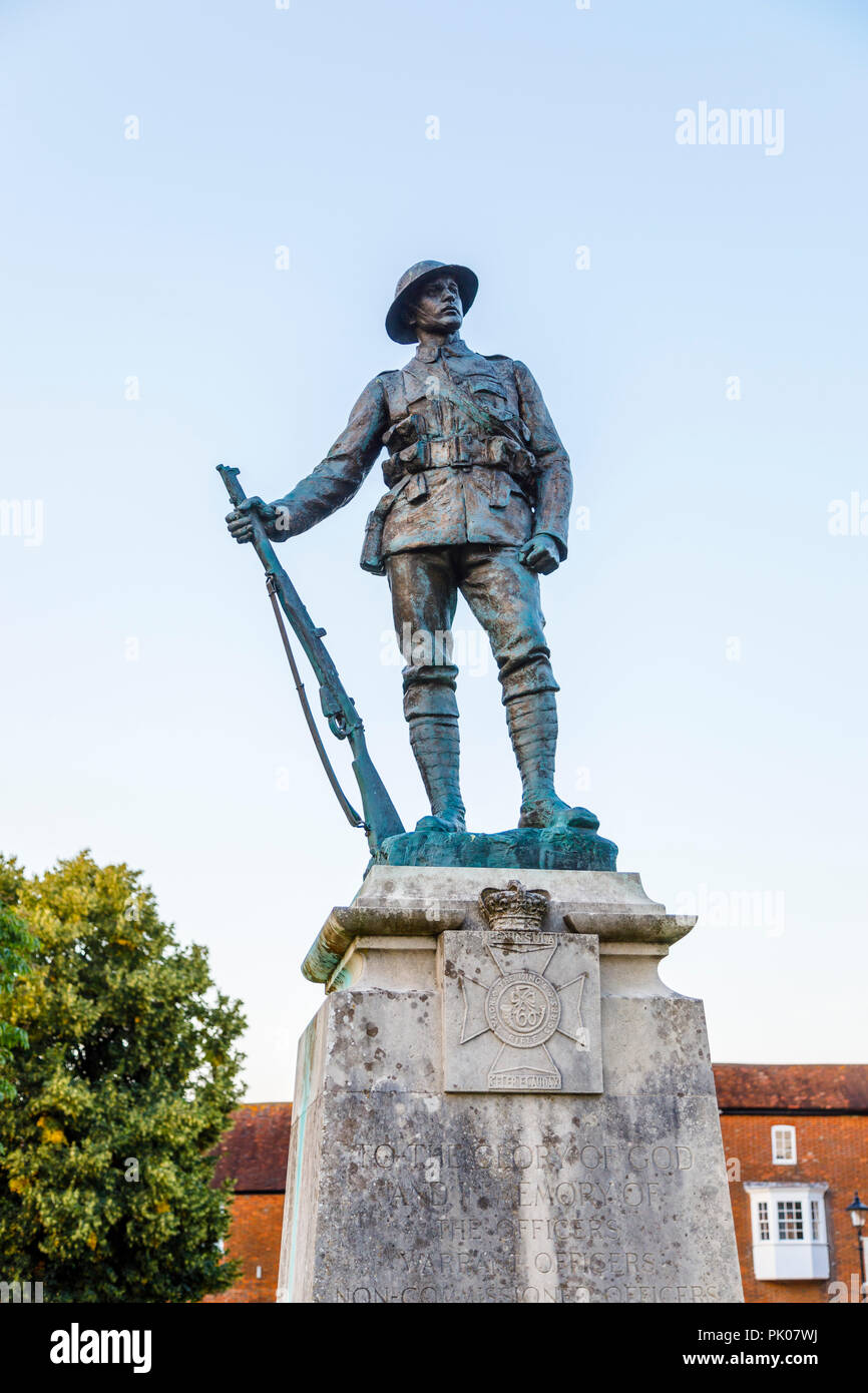 King's Royal Rifle Corps War Memorial, Winchester, statue of a soldier in Winchester Cathedral Close, Winchester, Hampshire, southern England, UK Stock Photo