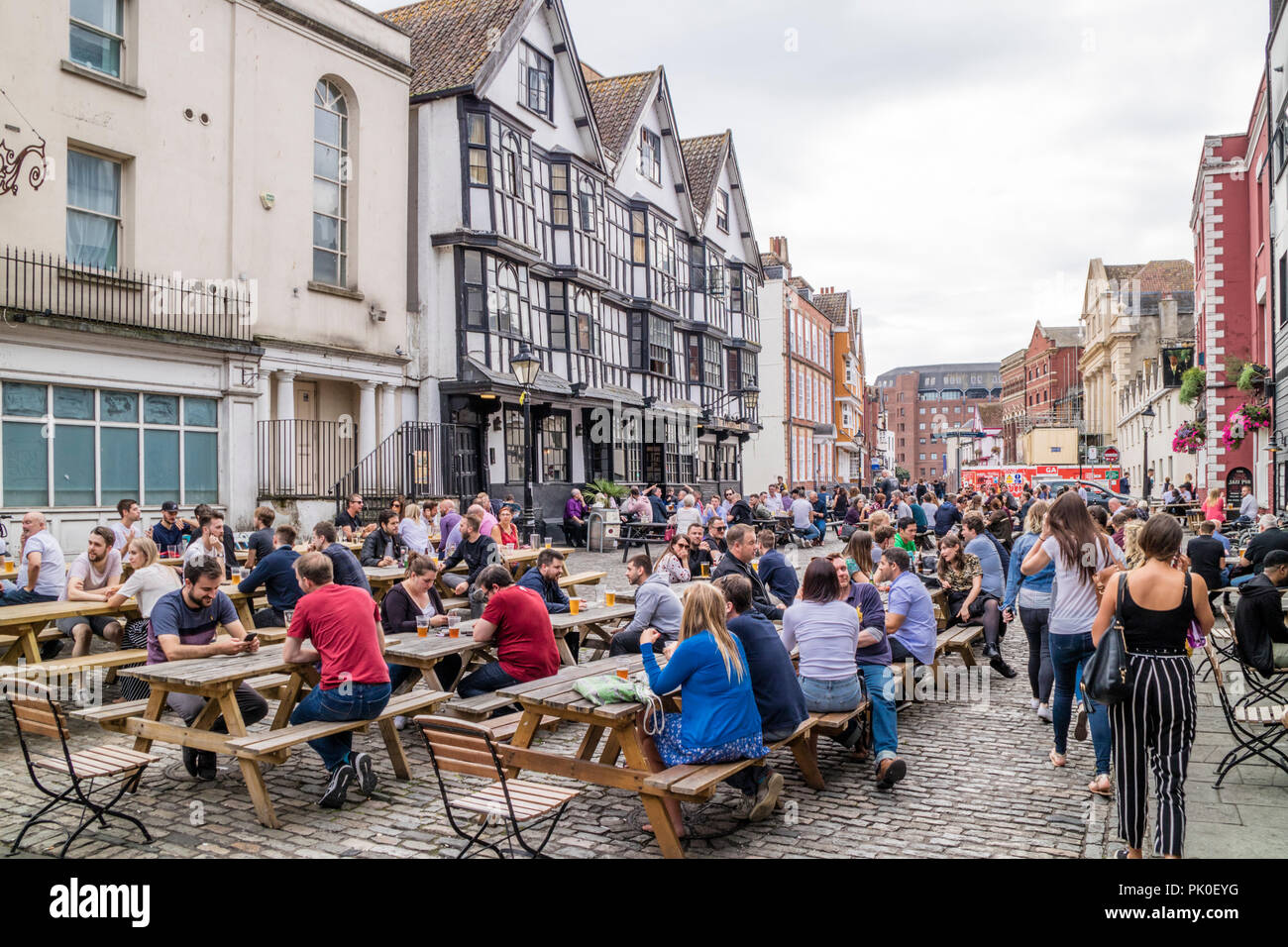 People relaxing at a pub in King Street in the city of Bristol, England, UK - Stock Image