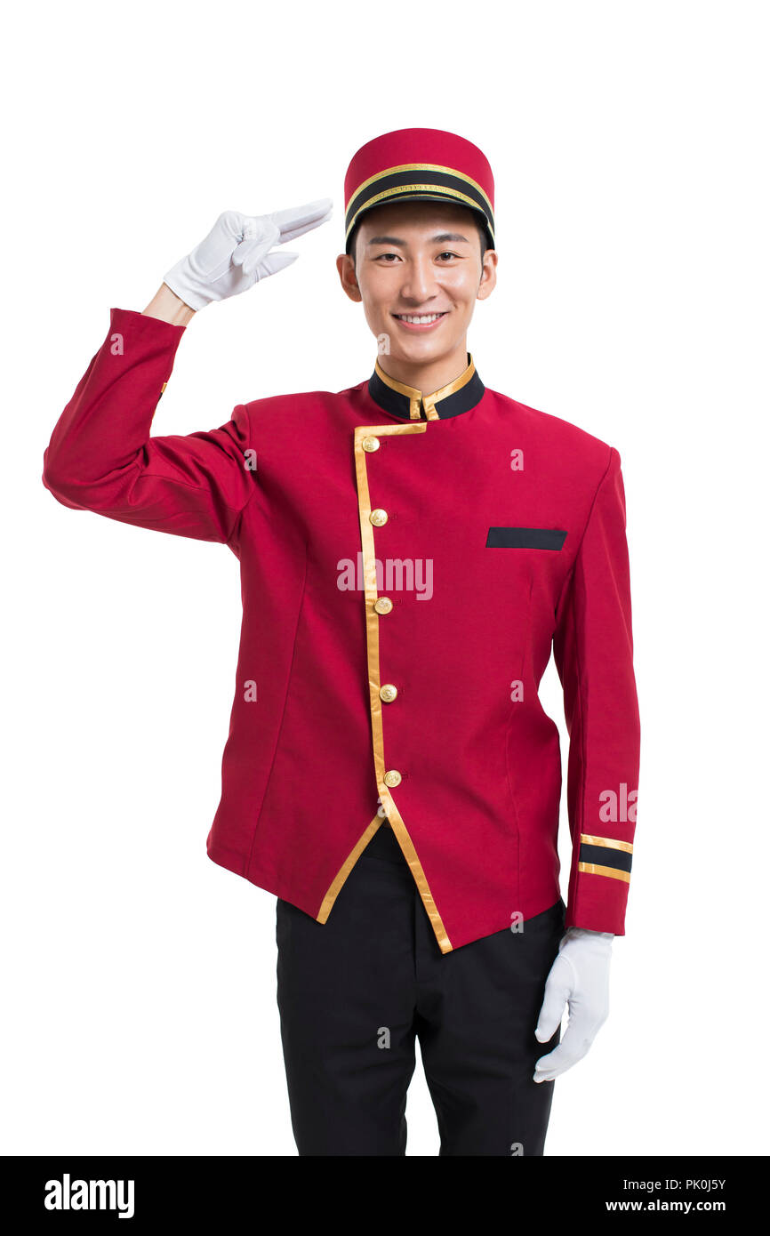 Young bellboy saluting - Stock Image