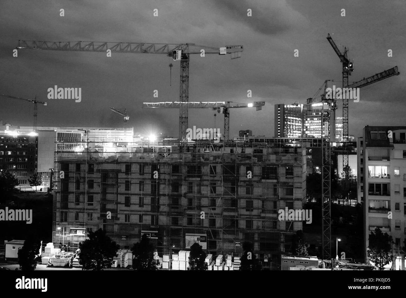 Constant 24-7 construction work in the old East Berlin now takes place, bringing two halves of one city united again as one - Stock Image