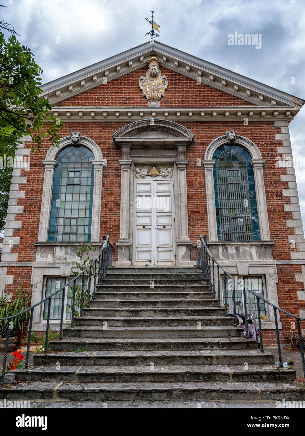 Grade I listed church of Trinity Green after the style of Sir Christopher Wren built in 1695 as part of Alms Houses for mariners in Whitechapel - Stock Image