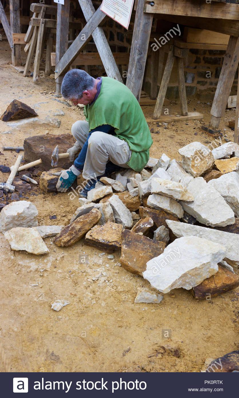 A stonemason working at Gudelon Castle, Burgundy, France