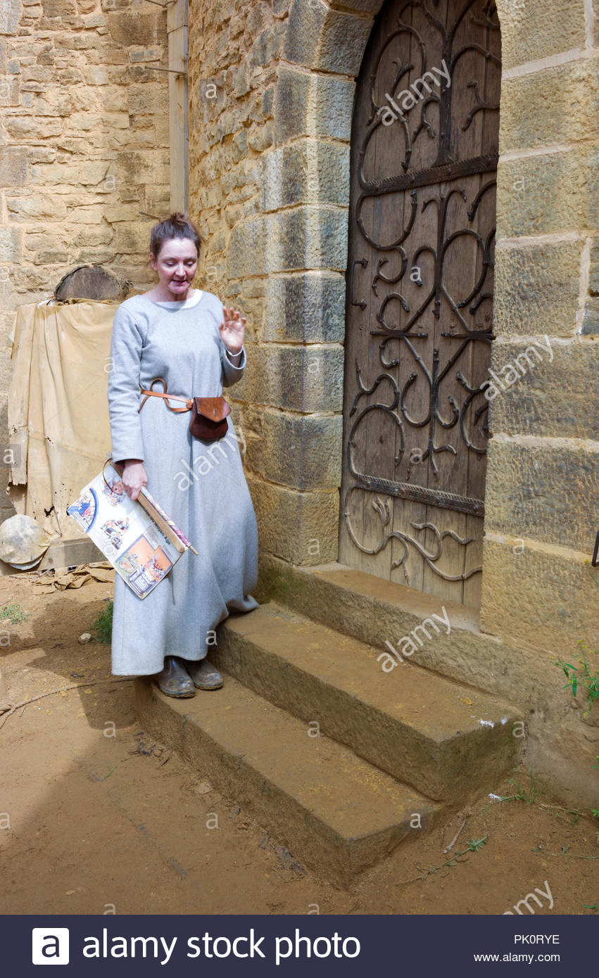 A guide in medieval costume, Gudelon Castle, Burgundy, France. The castle is being built entirely using medieval tools and building methods. Stock Photo
