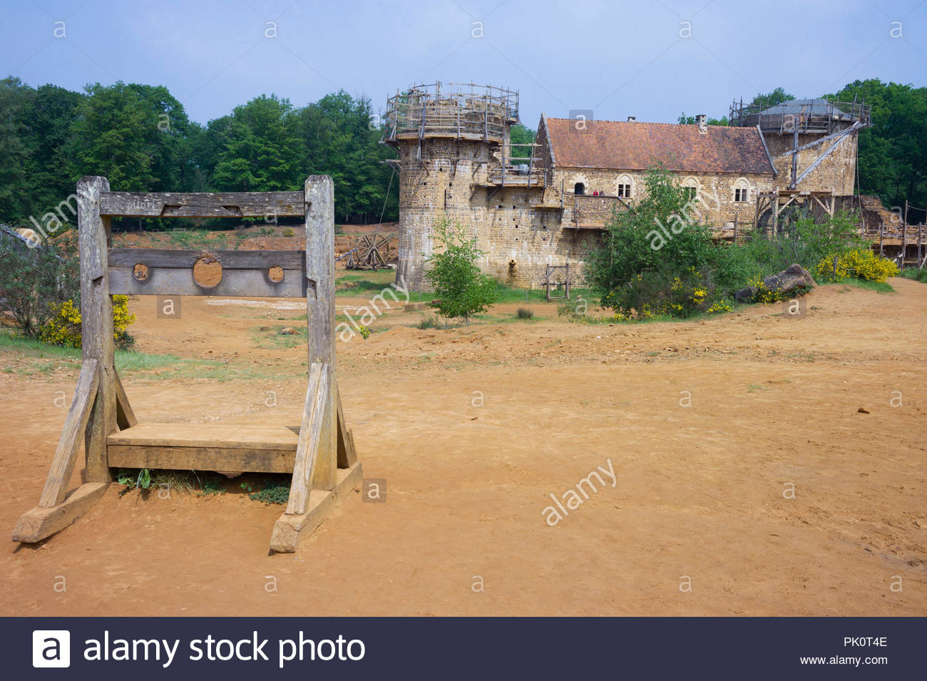 'Punishment' stocks at Gudelon Castle, Burgundy, France. The castle is being built entirely using medieval tools and building methods. Stock Photo