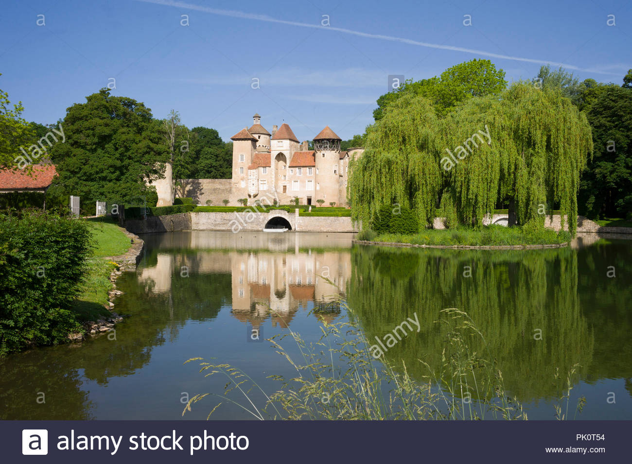 A chateau in Burgundy, France with an ornamental lake Stock Photo