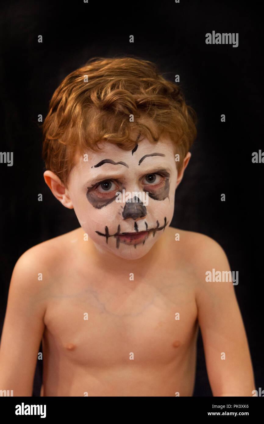 Four year old boy with skeleton face paint, Hampshire, England, united Kingdom. - Stock Image