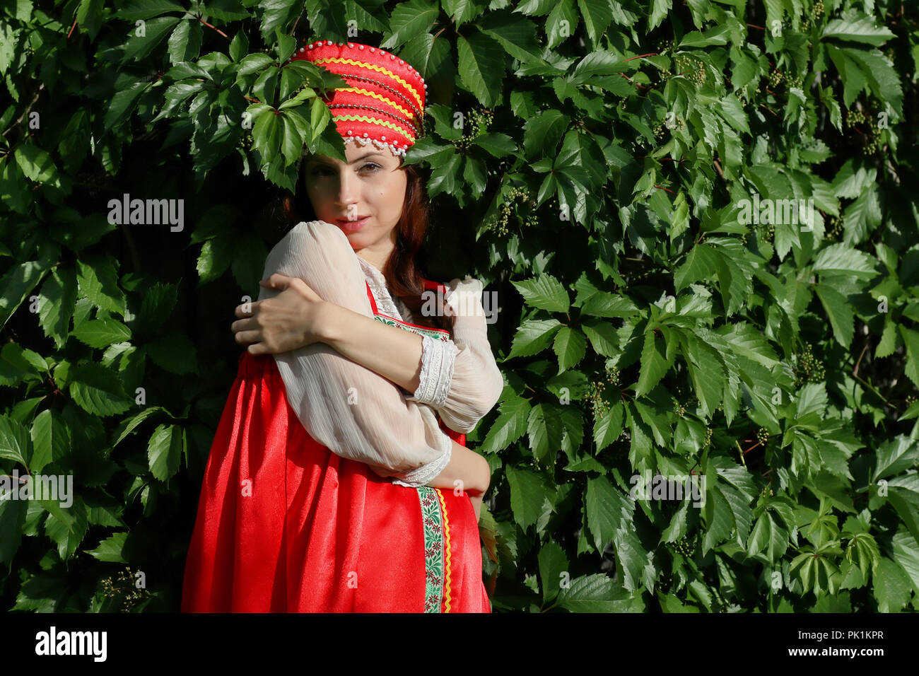 Slav in traditional dress ivy wall tree - Stock Image