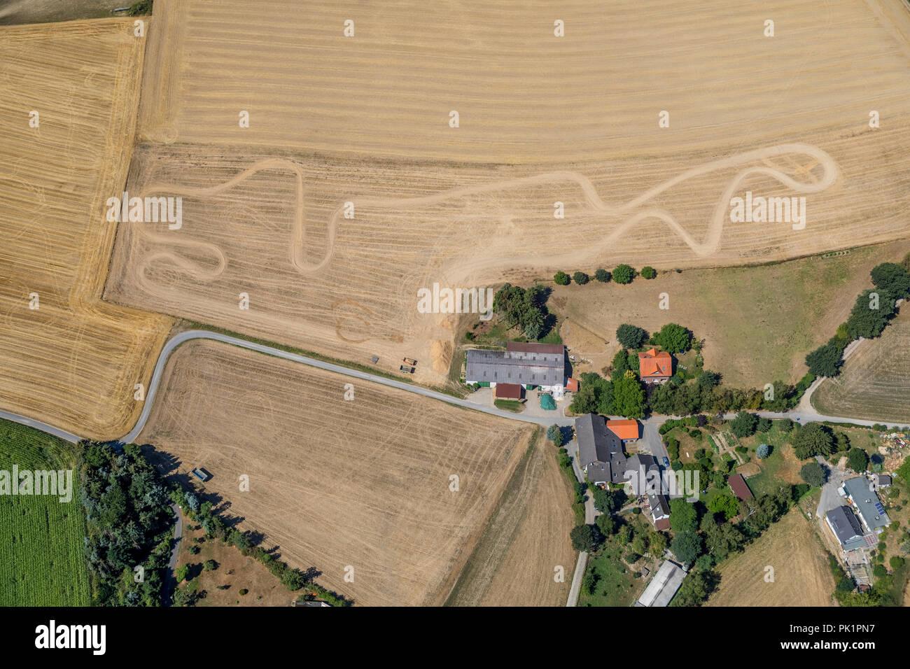 Motocross tracks on a field at Kleinhofweg in Heiligenhaus, drought, drought, hot summer, Heiligenhaus, Ruhr Area - Stock Image