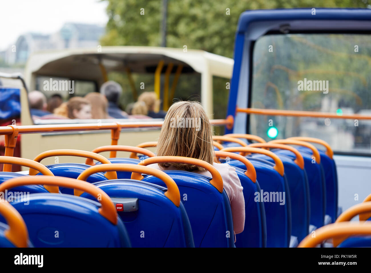 A sightseer on a London tourist bus . - Stock Image