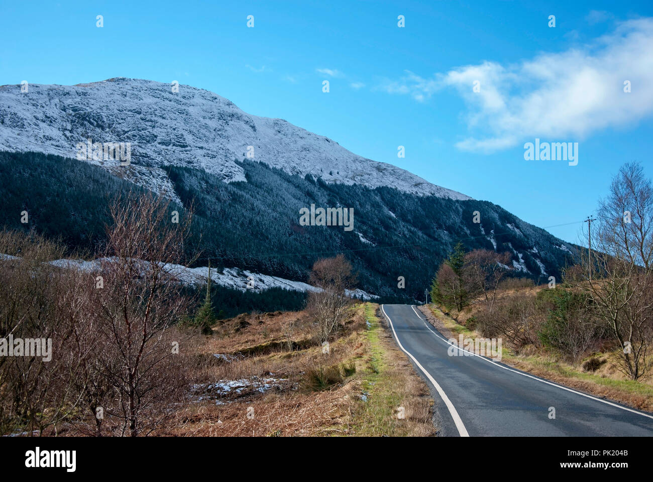 Glen Lean and Cruach Neuran on a Winters Day Clachaig Dunoon Argyll Scotland United Kingdom winter wintry landscape blue sky skies over snow covered m - Stock Image