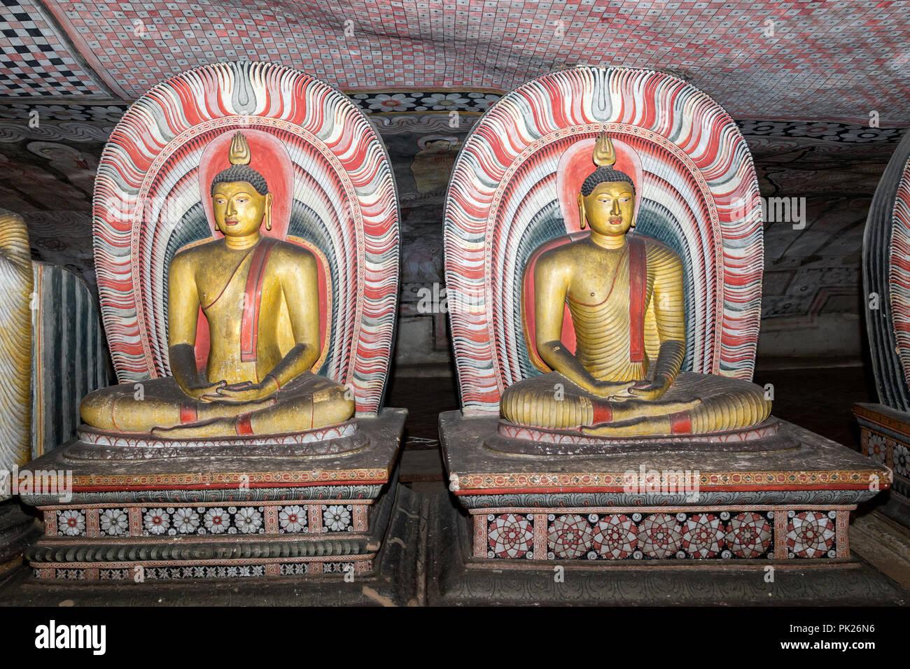 Buddha figures, Cave of the Great Kings, Dambulla Cave temple, Sri Lanka - Stock Image